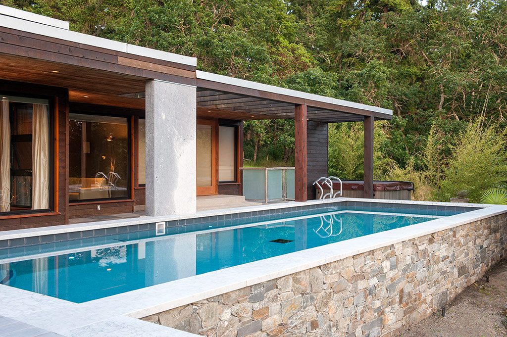 Outdoor eco pool elevates this modern home to luxury oasis for Garden oases pool entrance